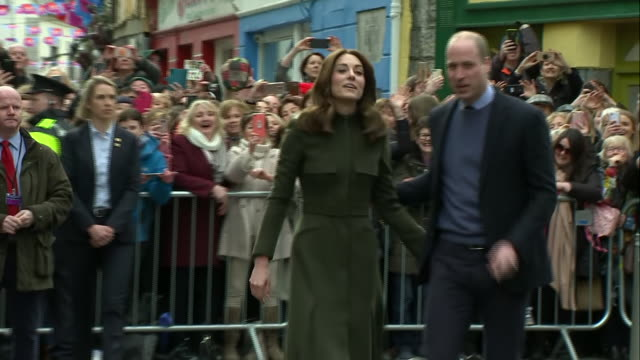 shows exterior shots prince william, duke of cambridge and catherine , duchess of cambridge, meeting members of the public and shaking hands on a... - dublin republic of ireland stock videos & royalty-free footage