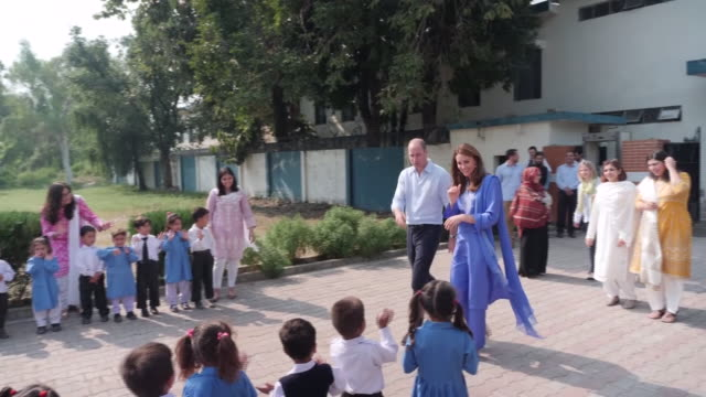 shows exterior shots prince william duke of cambridge and his wife catherine duchess of cambridge, interacting with children before deaparting after... - pakistan stock videos & royalty-free footage