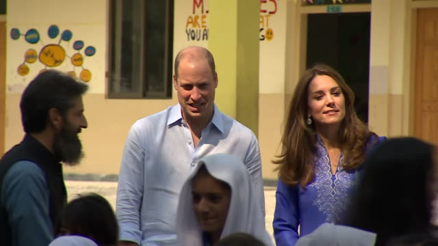 shows exterior shots prince william duke of cambridge and his wife catherine duchess of cambridge, posing for photo with students whilst visiting... - pakistan stock videos & royalty-free footage
