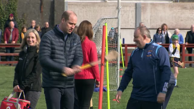 shows exterior shots prince william, duke of cambridge, being shown how to use a hurling stick at salthill gaelic athletic association club in... - western european culture stock videos & royalty-free footage