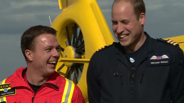 shows exterior shots prince william duke of cambridge on last day of work as an air ambulance pilot in east anglia including a photocall with his... - herzog von cambridge stock-videos und b-roll-filmmaterial