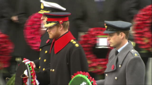 shows exterior shots prince william prince harry and prince andrew laying commemorative wreaths at the cenotaph in london the queen has led tributes... - 戦争記念碑点の映像素材/bロール
