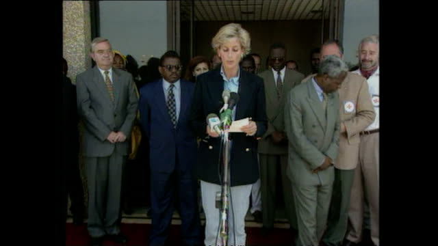 shows exterior shots princess diana at press conference in luanda speaking on visit to angola and campaign to ban landmines across the world.... - red cross stock videos & royalty-free footage