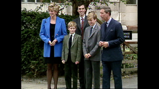 shows exterior shots princess diana followed by prince charles prince harry and prince william walking out of william's new schoolhouse on his first... - teilnehmen stock-videos und b-roll-filmmaterial