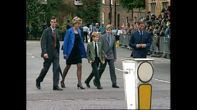 shows exterior shots princess diana prince charles prince harry and prince william posing for photographers before walking towards the camera along... - prinzessin stock-videos und b-roll-filmmaterial