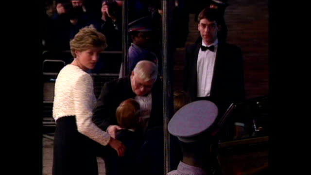 Shows exterior shots Princess Diana with Prince William and Prince Harry walking out of cinema and getting in car after the Royal Premiere of the...