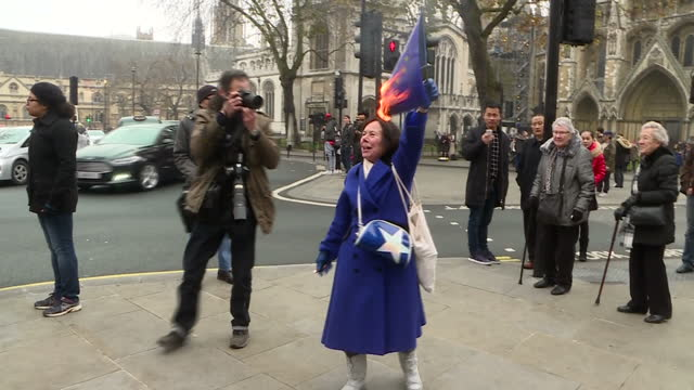 shows exterior shots probrexit supporter burning european union flag outside the supreme court in london while singing rule britannia far away from... - 2016 european union referendum stock videos and b-roll footage