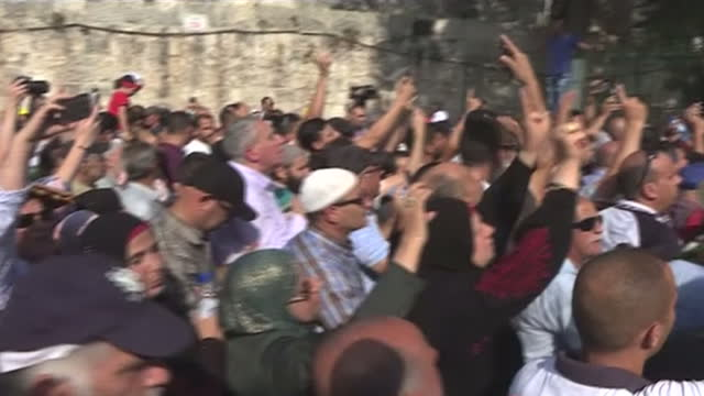 Shows exterior shots protesters celebrating in the street spraying champagne chanting and jumping Exterior shots eorshippers entering the alAqsa...