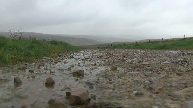 shows exterior shots puddles after rainstorm on stony road running through saddleworth moor ian brady one of the most notorious criminals in british... - northwest england stock videos and b-roll footage