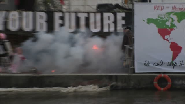 shows exterior shots punk memorabilia being burnt on board floating barge on the thames in london with people and firefighters watching from the bank... - punk music stock videos and b-roll footage