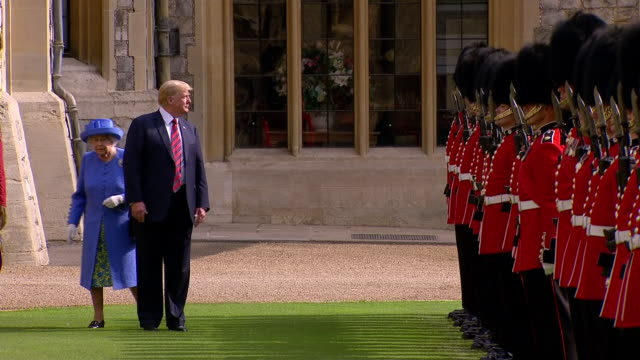 shows exterior shots queen eliabeth ii and donald trump president of usa inspecting guard at windsor castle on 14th july 2018 in windsor england... - windsor england stock videos and b-roll footage