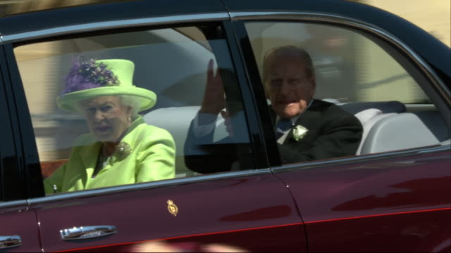 shows exterior shots queen eliabeth ii and prince philip duke of edinburgh arriving at st george's chapel in windsor castle for harry's wedding to... - st. george's chapel stock videos & royalty-free footage