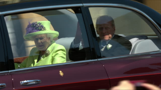 shows exterior shots queen elizabeth ii and her husband prince philip duke of edinburgh arriving at st george's chapel for the wedding of prince... - queen royal person stock videos & royalty-free footage