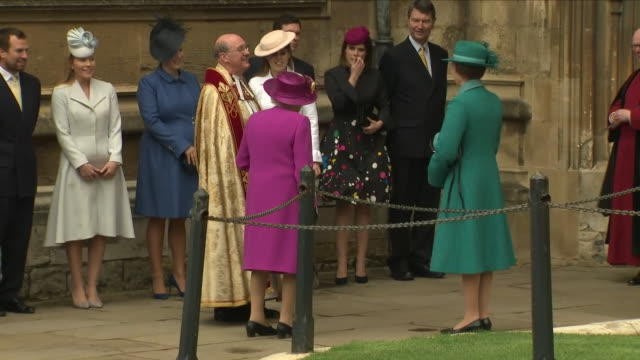 shows exterior shots queen elizabeth ii arriving at st george's chapel in windsor castle walking into the church followed by various members of the... - st. george's chapel stock videos and b-roll footage