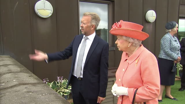 Shows exterior shots Queen Elizabeth II being shown source of Highland Spring water in Ochil Hills by Chief Executive Les Montgomery standing on the...