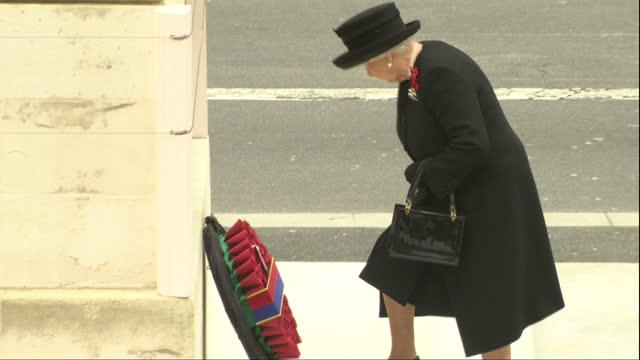shows exterior shots queen elizabeth ii of great britain laying commemorative wreath at the cenotaph in london the queen has led tributes to... - remembrance sunday stock videos & royalty-free footage