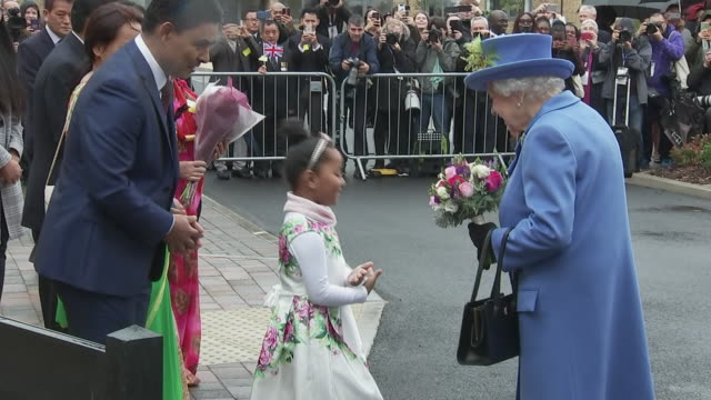 "shows exterior shots queen elizabeth ii receiving bunch of flowers from child, in front of street sign name for ""queen elizabeth terrace"" on visit to... - street name sign stock videos & royalty-free footage"