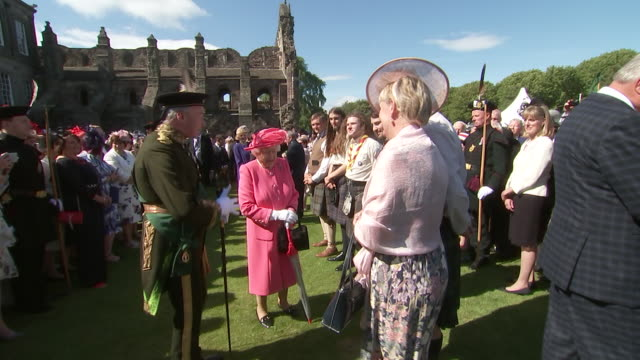shows exterior shots queen elizabeth ii shaking hands and talking to guests at a garden party at the palace of holyroodhouse on 3rd july 2019 in... - palace stock videos & royalty-free footage