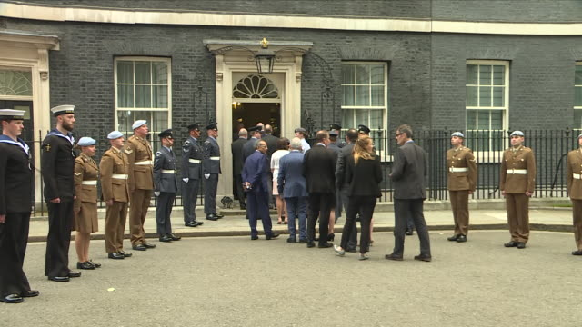 vídeos de stock e filmes b-roll de shows exterior shots red arrows hawk jet and guests arriving at downing street for reception to mark 100th anniversary of the raf including service... - centenário