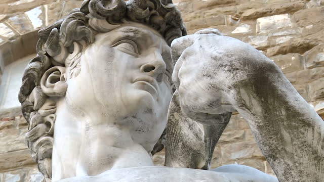 shows exterior shots replica of michaelangelo's statue of david in the sculpture's original position in front of the palazzo della signoria florence... - renaissance stock-videos und b-roll-filmmaterial