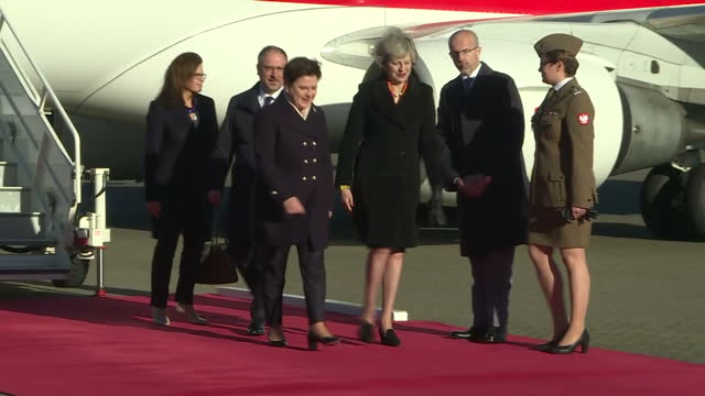 shows exterior shots republic of poland plane taxiing at raf northolt ground staff laying red carpet in wind and polish prime minister beata szydlo... - prime minister of the united kingdom stock videos and b-roll footage