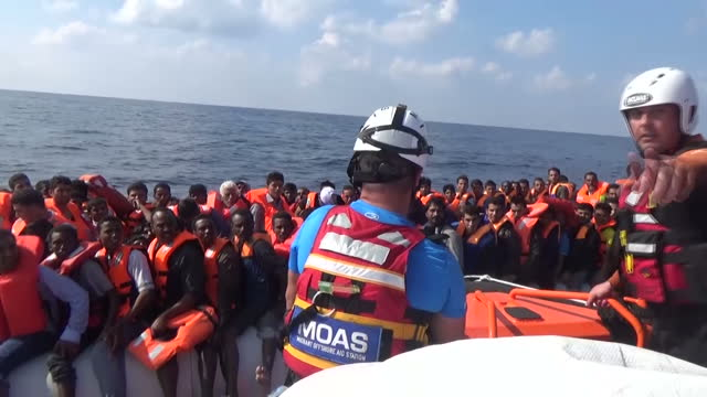 voiced shows exterior shots rescuers on moas boat searching for migrant boats as dawn breaks interior and exterior shots moas rescuer workers... - coast guard stock videos and b-roll footage