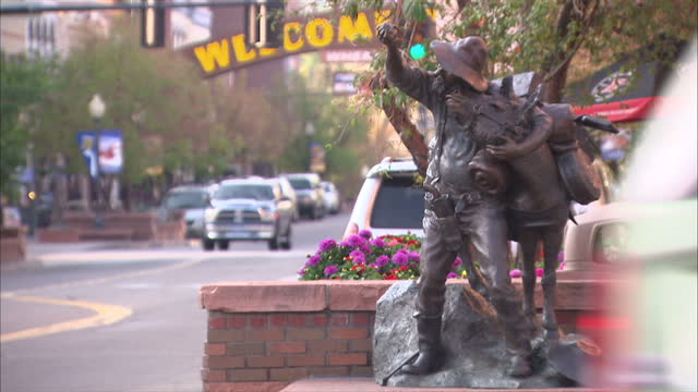 shows exterior shots road sign cars driving in downtown golden statue of a miner called golden touch on october 03 2012 in colorado co - california gold rush stock videos and b-roll footage