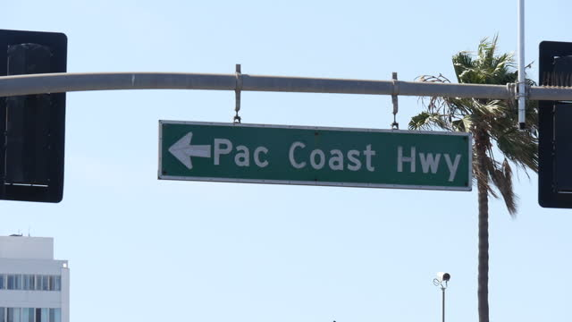 shows exterior shots road signs for 'pacific coast highway' and 'ocean' in santa monica on 26th july 2017 in california usa - route 001 stock videos & royalty-free footage
