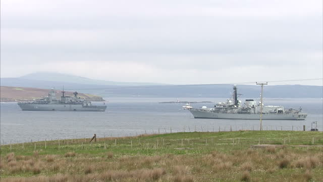 shows exterior shots royal navy ship and german navy frigate in scapa flow off the island of hoy in preparation for battle of jutland commemorations... - hoy stock videos & royalty-free footage