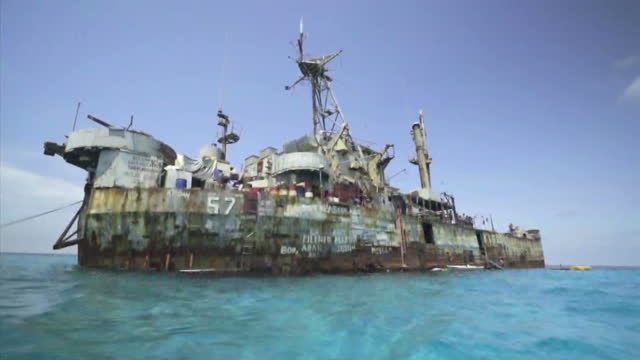 shows exterior shots rusting hulk of the sierra madre a usbuilt philippine navy landing craft brp sierre madre which was run aground on second thomas... - south china sea stock videos & royalty-free footage