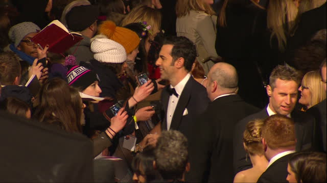 vídeos de stock, filmes e b-roll de shows exterior shots sacha baron cohen and isla fisher signing autographs for fans the 2016 baftas film awards ceremony at was held at london's royal... - sacha baron cohen