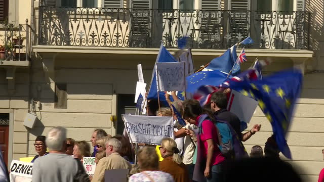 shows exterior shots santa maria novella church and square outside with pro-europe anti-brexit protesters and police cars parked outside building... - brexit stock videos & royalty-free footage