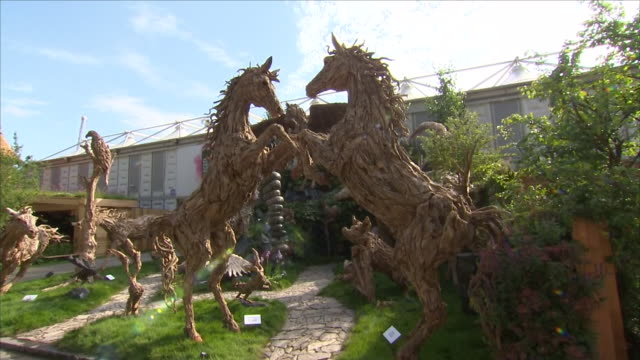 shows exterior shots sculptures of horses in display garden at the chelsea flower show on 21st may, 2018 in london, england, united kingdom - chelsea flower show stock videos & royalty-free footage