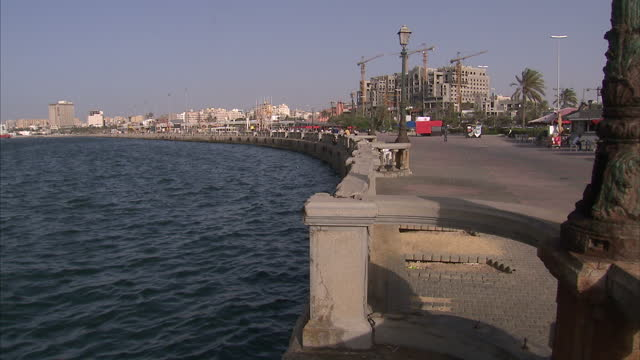 shows exterior shots sea wall in tripoli ship coming into the port on june 06 2015 in tripoli libya - acquascooter video stock e b–roll