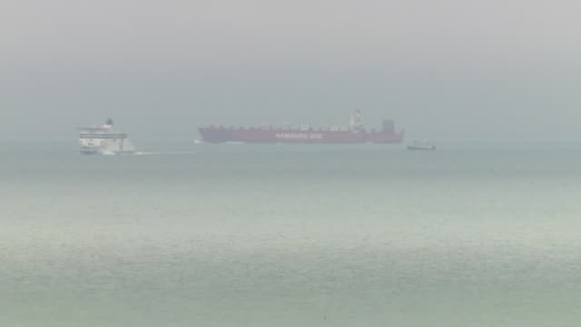 shows exterior shots shipping in the english channel, including container ships, tankers and ferries going past dover. a total of 69 migrants have... - sea channel stock videos & royalty-free footage