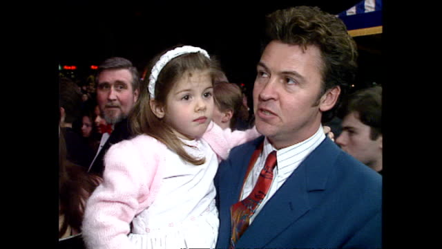 shows exterior shots singer paul young with family leaving following the royal premiere of the film 'hook' and soundbite interview on his daughter's... - hook stock videos & royalty-free footage