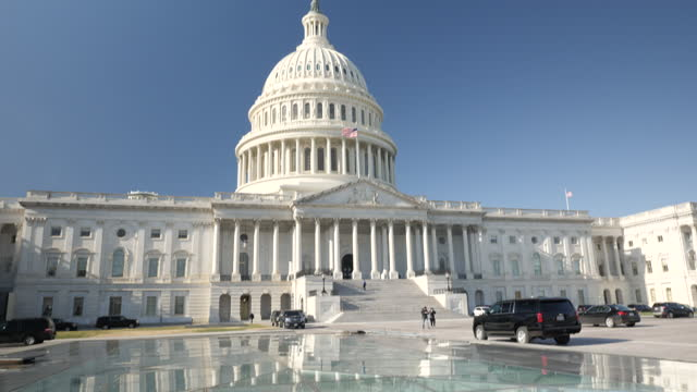 shows exterior shots smoke rising from vents in the ground in front of the us capitol building on a sunny day on 19th december, 2019 in washington... - winter stock videos & royalty-free footage