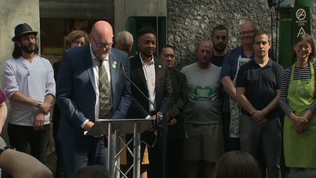 Shows exterior shots speech announcing reopening of Borough Market following terror attack and trader Paul Wheeler ringing bell to signal opening of...