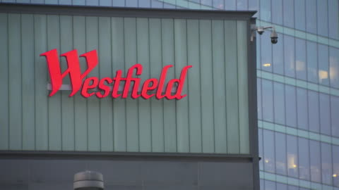 stockvideo's en b-roll-footage met shows exterior shots stratford railway station, london red buses outside, and shoppers arriving and departing from westfield, stratford east london... - shopping centre