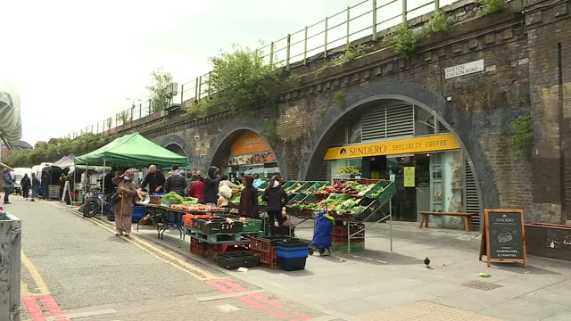 shows exterior shots street market in brixton, underneath raised railway embankment with underground train passing by, on 23rd may, 2021 in london,... - market stock videos & royalty-free footage
