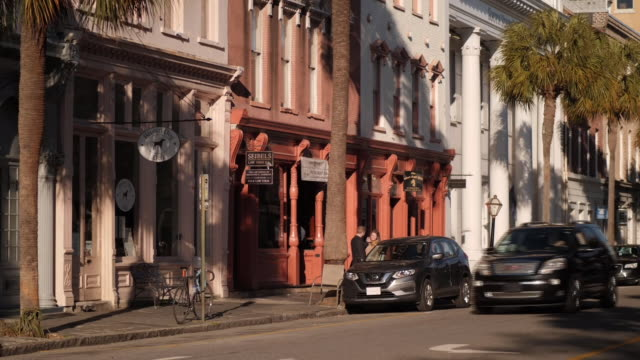 shows exterior shots street scenes in charleston, cars driving, pedestrians walking along sidewalks, people at cafes and restaurants in south... - south carolina stock videos & royalty-free footage