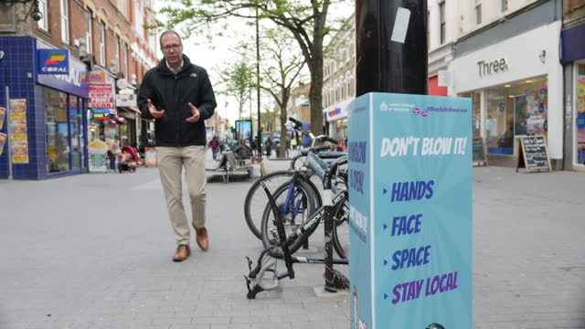 shows exterior shots street scenes in hounslow, london, with volunteers handing out leaflets and raising awareness of vaccination against covid 19,... - city stock videos & royalty-free footage