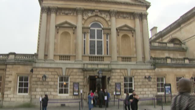 shows exterior shots streetscenes in city of bath including traffic on road shoppers and tourists walking along the streets and past shopsand... - for sale englischer satz stock-videos und b-roll-filmmaterial