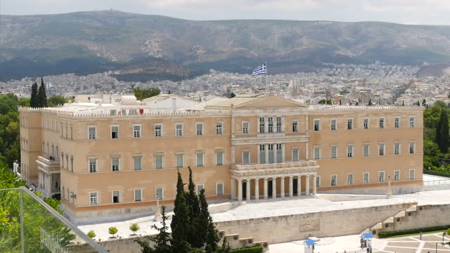 shows exterior shots the front of the hellenic parliament greek flag flying on top on june 28 2015 in athens greece - panathinaiko stadium stock videos & royalty-free footage