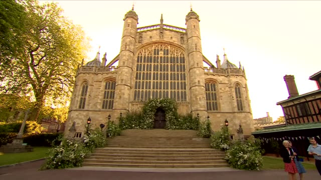 shows exterior shots the great west door of st george's chapel in windsor castle decorated with flowers in preparationf for the wedding of prince... - chapel stock videos & royalty-free footage