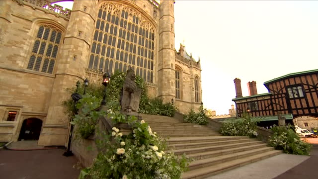 shows exterior shots the great west door of st george's chapel in windsor castle decorated with flowers in preparationf for the wedding of prince... - königliche hochzeit stock-videos und b-roll-filmmaterial