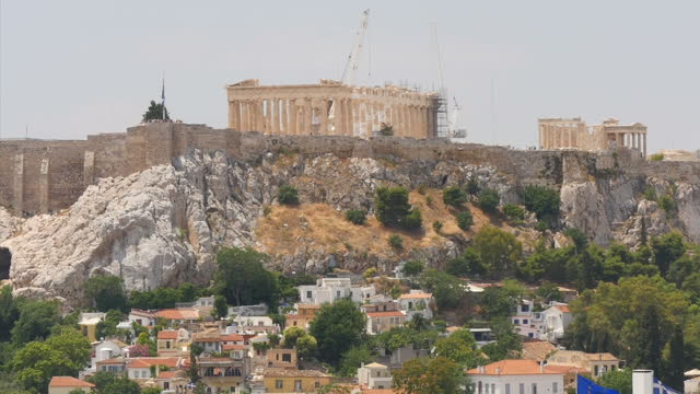 shows exterior shots the parthenon the acropolis the greek flag eu flag flying together on top of a building's roof on june 28 2015 in athens greece - panathinaiko stadium stock videos & royalty-free footage