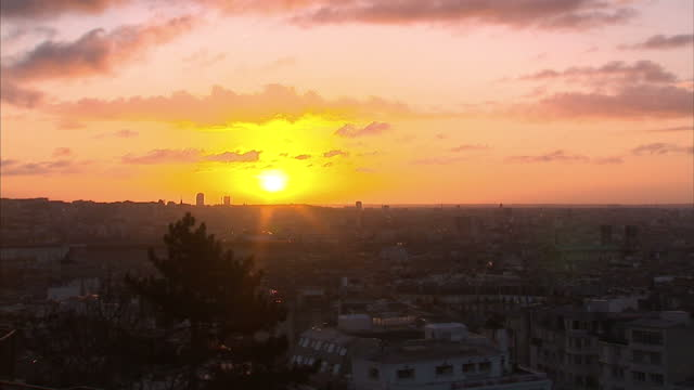 shows exterior shots the sun setting over the city of paris on january 11 2015 in paris france - basilique du sacre coeur montmartre stock videos & royalty-free footage
