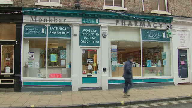 shows exterior shots timelapse crowds walking through streets in york england exterior shots monkbar pharmacy in york and posters in window about flu... - francis crick stock videos & royalty-free footage