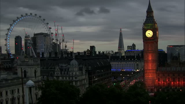 Shows exterior shots timelapse film going from day to night Big Ben on the Houses of Parliament and The London Wheel in London on the 11th June 2017...